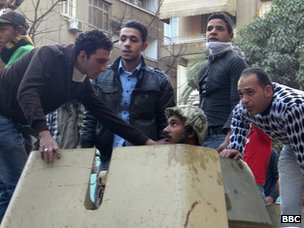 Egyptian protesters speak with army soldier on APC