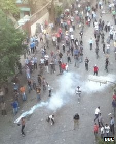 protester in Egypt throws back tear gas canister