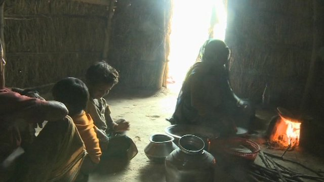 Family sitting on floor in India