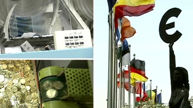 Euro coins being made and European flags