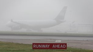 Plane in thick fog at Heathrow Airport