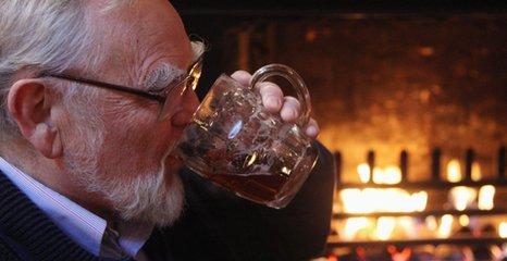 Enjoying a pint by the fire