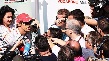 Jenson Button faces the media at the 2010 Brazilian Grand Prix