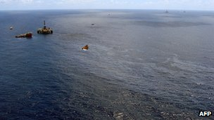 Supply boats cleaning an oil spill around a Chevron platform operating in the Frade oil field offshore of Rio de Janeiro, Brazil