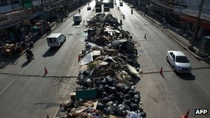 Rubbish piled up on a Bangkok road on 18 November 2011
