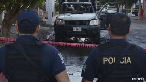 ... bodies in two pick-up trucks in Culiacan, the capital of Sinaloa state.