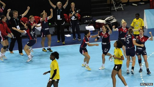Great Britain&#039;s players celebrate victory over Angola