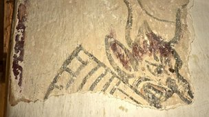 Medieval wall painting of Sloth at St Cadoc's Church, Llancarfan