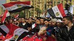 Demonstrators wave Egyptian flags in Cairo (25 November 2011)