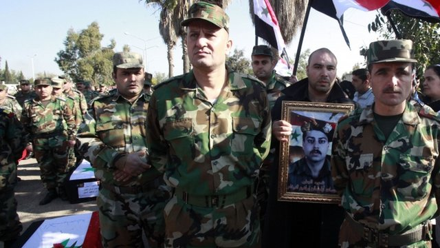 Syrian soldiers attend funeral