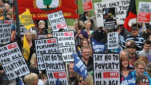 Protesters holding say no to poverty placards