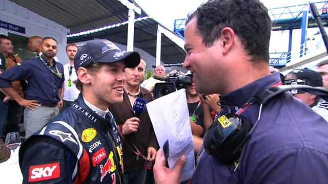World champion Sebastian Vettel talks to BBC F1 reporter Ted Kravitz