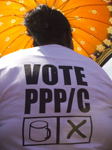 Woman with a PPP/C T-shirt at an election rally in Guyana