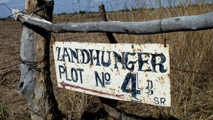 Sign saying &#039;Landhunger plot number 4&#039; on rudimentary gate