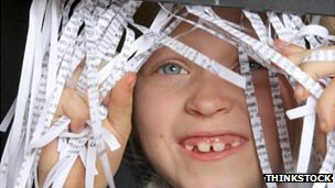 Child with shredded paper