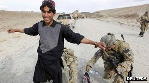 U.S. soldiers frisk a resident during a patrol in Wardak province