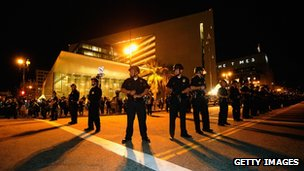 LA police officers in riot gear form a skirmish line, 28 November 2011