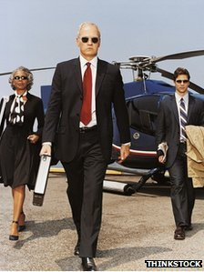 Business people with helicopter