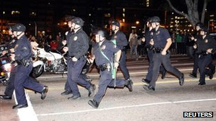 "Police officers in Los Angeles wore riot gear to confront ""Occupy"" protesters"
