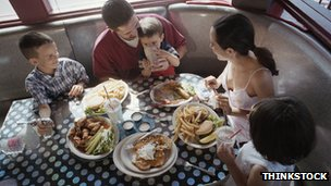 Family eating in a diner booth