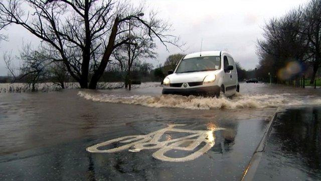Van driving through a flooded road