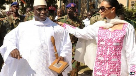President Yahya Jammeh (L) speaks with his wife, Zeineb Souma Jammeh, on 24 November 2011 as he leaves a polling station in the capital Banjul
