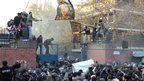 Protesters at the gates of the British embassy in Tehran, Iran, on 29 November 2011