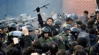 Riot police try to hold back protesters at the British embassy in Tehran, Iran, on 29 November 2011