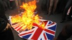 The British flag is burned outside the British embassy in Tehran, Iran, on 29 November 2011