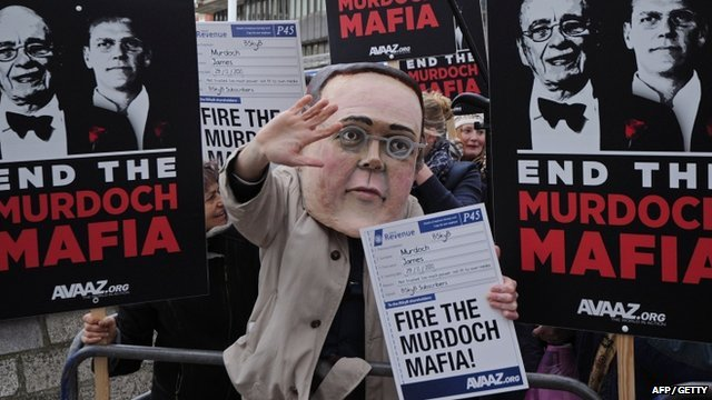 Demonstrators gather outside the Queen Elizabeth II Centre as BSkyB hold their annual general meeting