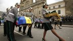 Colombian army honour guards carry the coffin of a killed comrade during his funeral in Bogota's cathedra