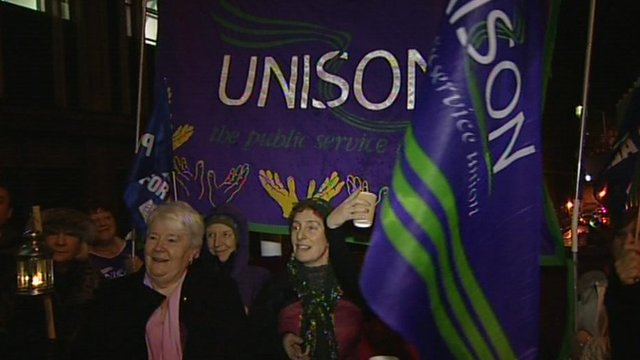 Hospital staff in Bristol hold flags on picket line