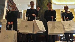 Girls carrying Prada bags