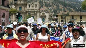 Protesters march during a strike against Newmont's  Conga gold mine in Cajamarca 25 November 2011