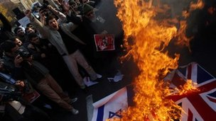 Protesters set fire to the British and Israeli national flags in the Iranian capital on 29 November 2011 in Tehran, Iran.