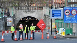 Unite members strike outside the Liverpool entrance to the Birkenhead Tunnel which has been closed for the day.