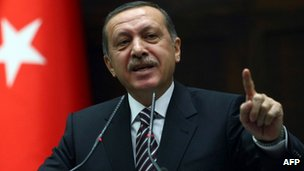 Turkeys Prime Minister Recep Tayyip Erdogan gestures while addressing members of Parliament from his ruling AK Party during a meeting at the parliament in Ankara, on November 15, 2011