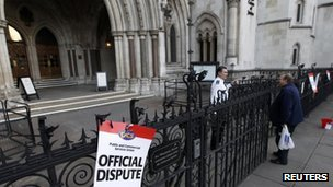 Placards outside the High Court