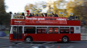A bus carrying union members drives through Parliament Square in central London November 30, 2011.