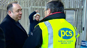 First Minister Alex Salmond speaks to picketers outside the Scottish Parliament.