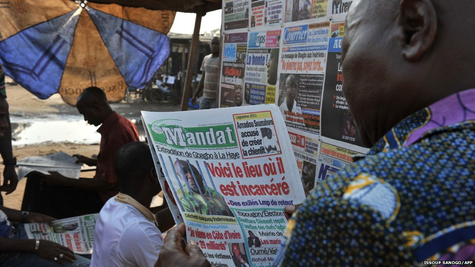 A man reads a local newspaper in Abidjan, Ivory Coast