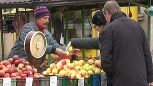 Latvians at market getting on with everyday life in the face of tough austerity