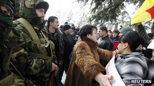 Alla Dzhioyeva (C) outside the central Election Commission building in Tskhinvali (30 Nov 2011)