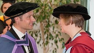 Andy Priaulx receives his honorary doctorate from Professor Val Latimer, head of the School of Nursing Sciences at the University of East Anglia