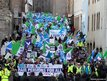 Protesters march down the Royal Mile from Edinburgh Castle to the Scottish Parliament in protest at pension cuts