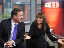 Prime Minister David Cameron and TV presenter Carol Vorderman.