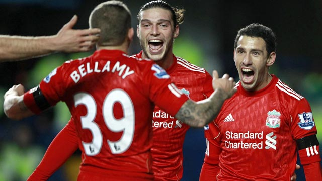 Liverpool celebrate Maxi Rodriguez's opening goal