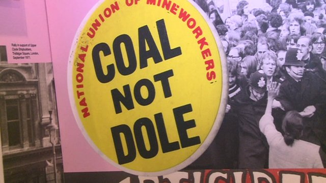 A National Union of Mineworkers sign saying 'Coal not Dole'