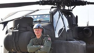 Prince Harry with an Apache helicopter