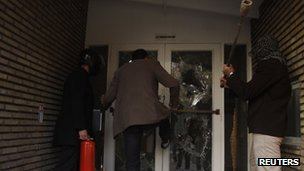 Protesters break through a door in the British embassy compound in Tehran 29 November 2011